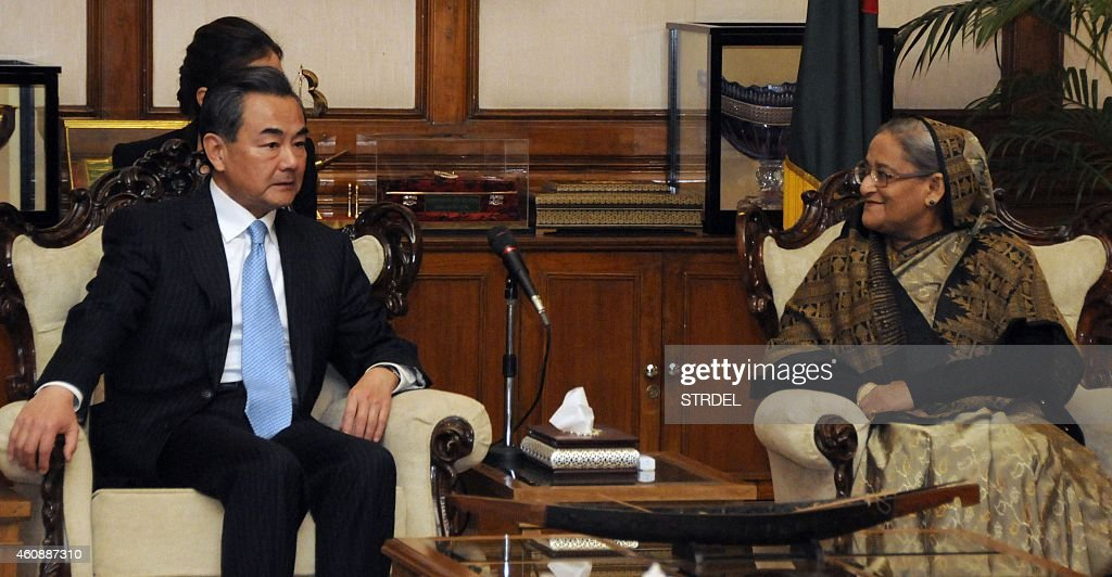 Bangladeshi Prime Minister Sheikh Hasina Wajid (R) speaks with visiting Chinese Foreign Minister Wang Yi during a meeting in Dhaka on December 29, 2014. China has offered to sign a free trade agreement with Bangladesh to try to narrow a growing trade gap, the Bangladeshi foreign minister said. Chinese Foreign Minister Wang Yi made the proposal during talks with his counterpart in Dhaka in a move which local exporters described as a 'huge development'. AFP PHOTO/STR