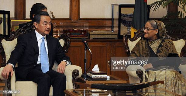 Bangladeshi Prime Minister Sheikh Hasina Wajid speaks with visiting Chinese Foreign Minister Wang Yi during a meeting in Dhaka on December 29 2014...