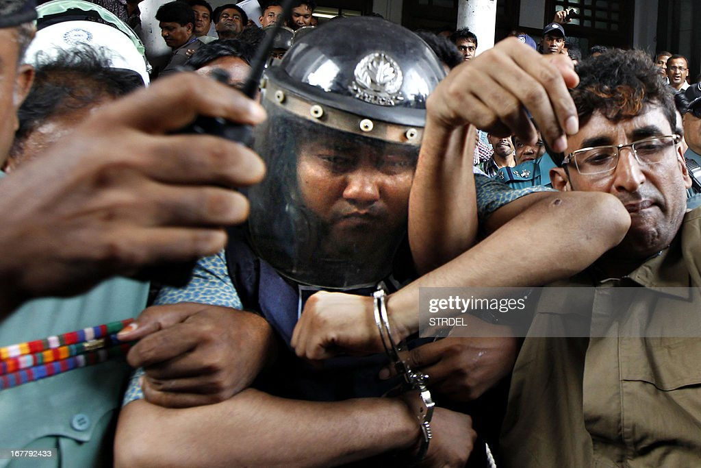 Bangladeshi property tycoon Sohel Rana (C), seen wearing police-issue body armour and helmet, is escorted for his appearance at the High Court in Dhaka on April 30, 2013. Bangladesh defended Tuesday its decision to snub foreign aid after the collapse of a garment factory complex where at least 388 people died as the UN revealed it had offered specialist help to find survivors.