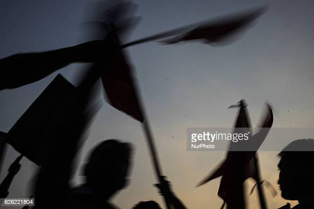 Bangladeshi protesters wave red flag during a protest demanding the scrapping of the proposed Rampal power plant in Dhaka Bangladesh 26 November 2016...