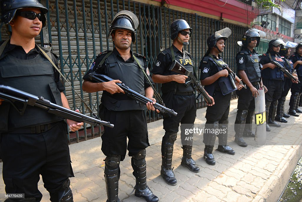 Bangladeshi Rapid Action Battalion (RAB) personnel stand guard during a nationwide strike called by the opposition Bangladesh Nationalist Party (BNP) in protest against the detention of their leaders, in Dhaka on March 28, 2013. Schools and businesses were shut across Bangladesh on the second day of a general strike called by the country's main opposition party and Islamic allies. AFP PHOTO/Munir uz ZAMAN