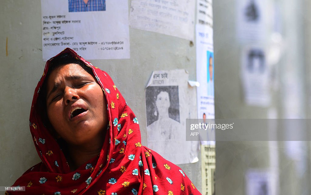A Bangladeshi relative cries after identifying her daughter's dead body from the rubble of a collapsed eight-storey building in Savar, on the outskirts of Dhaka, on May 2, 2013. Bangladesh authorities have suspended the mayor of Savar satellite town outside the capital for approving the faulty construction of a building that collapsed last week, killing 429 people. AFP PHOTO/ Munir uz ZAMAN