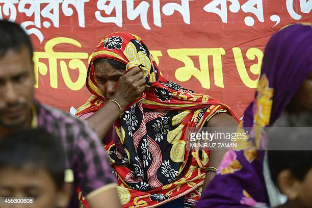 A Bangladeshi relative of a victim of the Rana Plaza building collapse mourns during a protest to demand compensation for those affected in Dhaka on...