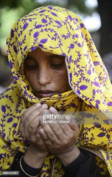 A Bangladeshi relative of a victim of the Rana Plaza building collapse prays during an event marking the first anniversary of the disaster in Dhaka...