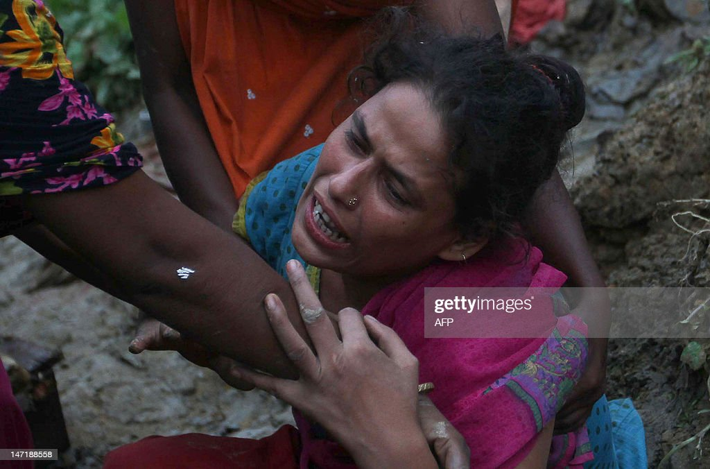 A Bangladeshi relative of landslide victims mourns in Chittagong on June 27, 2012. Nearly 90 people have been killed in landslides in southeast Bangladesh after three days of rains that triggered flash floods and severed transport links, officials said.