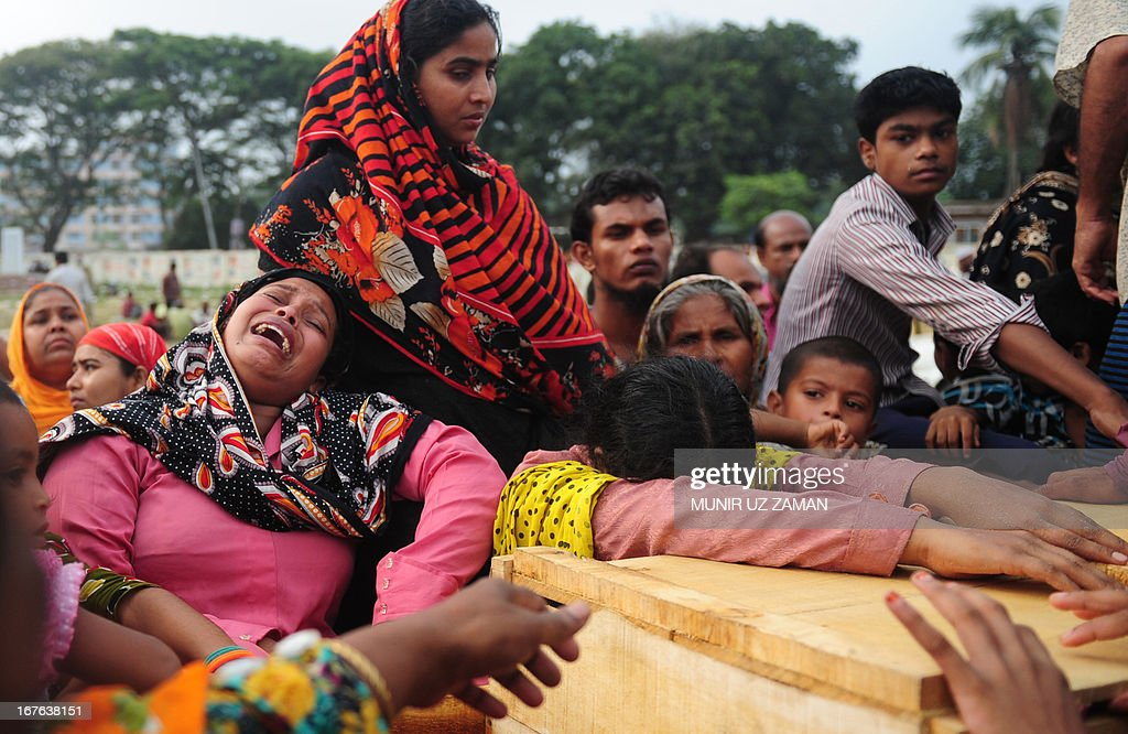 Bangladeshi relatives of Mohammad Abdullah react after looking into the coffin three days after an eight-storey building collapsed in Savar, on the outskirts of Dhaka on April 27, 2013. Police arrested two textile bosses over a Bangladeshi factory disaster as the death toll climbed to 332 and distraught relatives lashed out at rescuers trying to detect signs of life. AFP PHOTO/ Munir uz ZAMAN