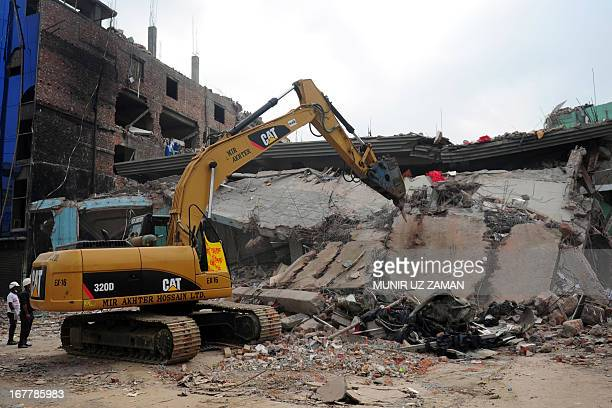 Bangladeshi rescuers work as Bangladeshi Army personel continue the second phase of the rescue operation using heavy equipment after an eightstorey...