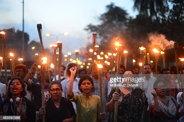 Bangladeshi secular activists take part in a torchlit protest against the killing of blogger Niloy Chakrabarti who used the penname Niloy Neel in...