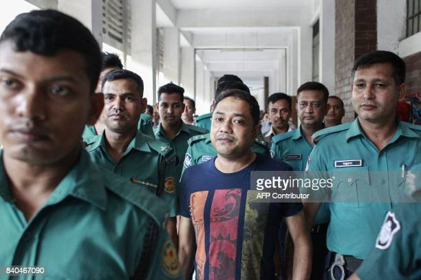 Bangladeshi security personnel escort Sohel Rana owner of the collapsed Rana Plaza building after a court appearance in Dhaka on August 29 2017 A...