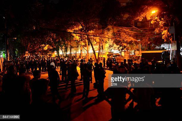 TOPSHOT Bangladeshi security personnel stand guard after gunmen stormed a restaurant in Dhaka's highsecurity diplomatic district early on July 2 2016...