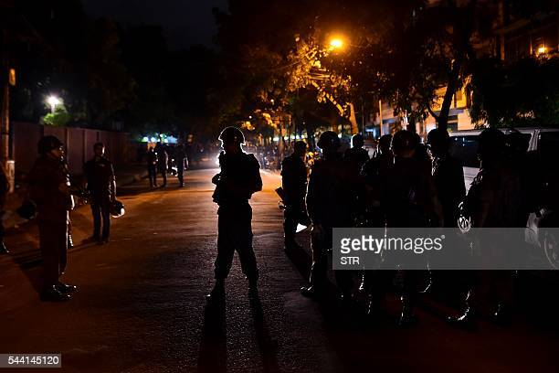 Bangladeshi security personnel stand guard after gunmen stormed a restaurant in Dhaka's highsecurity diplomatic district early on July 2 2016 Gunmen...