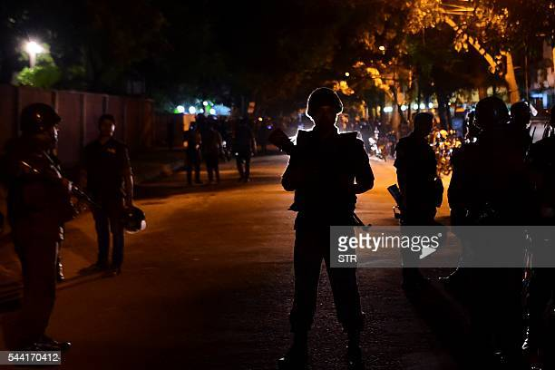 Bangladeshi security personnel stand guard after gunmen stormed the Holey Artisan Bakery restaurant in Dhaka's highsecurity diplomatic district early...