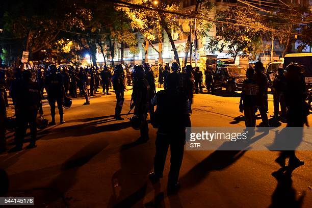 Bangladeshi security personnel stand guard outside a restaurant during an attack in Dhaka's highsecurity diplomatic district early on July 2 2016...