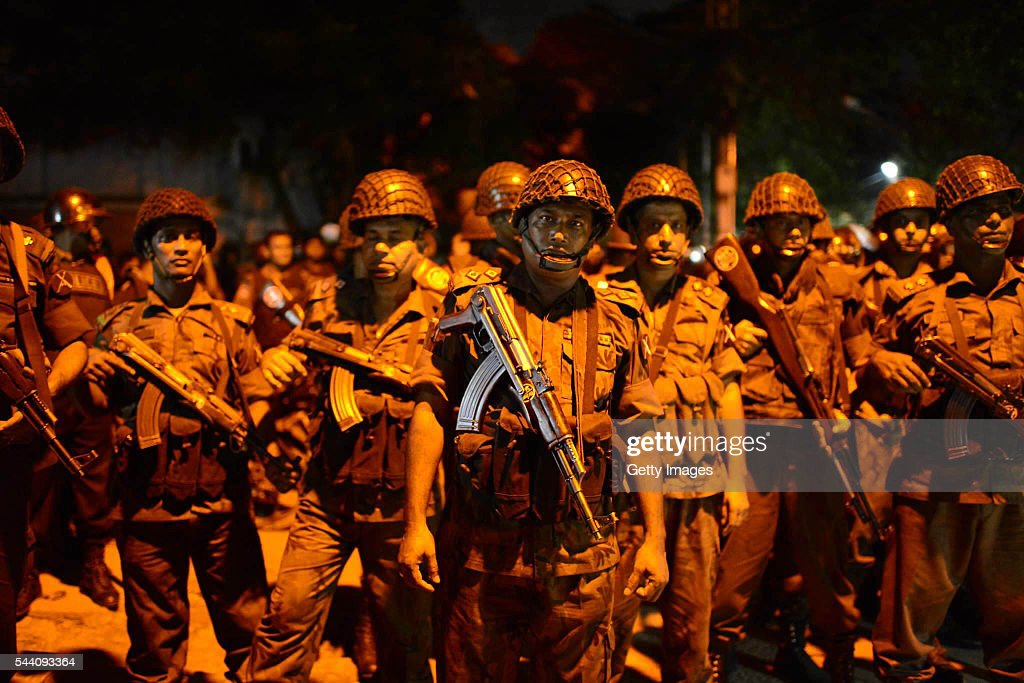Bangladeshi security stand guard near a restaurant that has been attacked by unidentified gunmen in the early hours of July 2, 206 in Dhaka, Bangladesh. Gunmen have taken at least 20 foreigners hostage at a restaurant in the diplomatic area of Dhaka, the capital of Bangladesh.