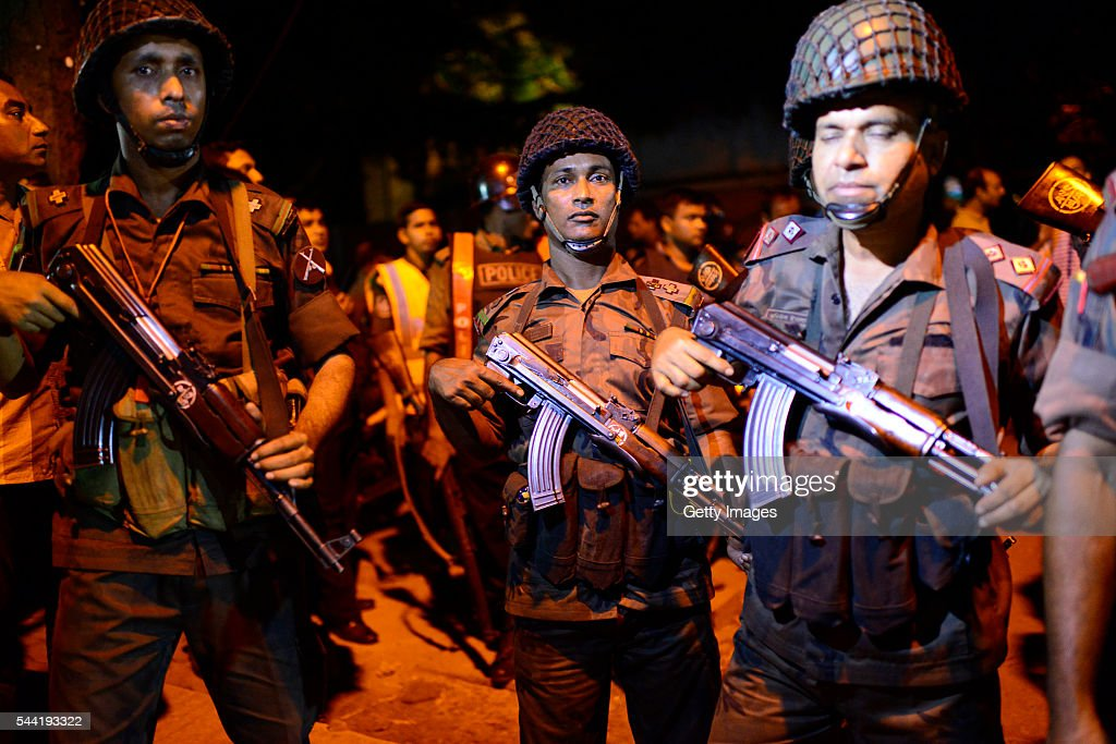 Bangladeshi security stand guard near a restaurant that has been attacked by unidentified gunmen in the early hours of July 2, 206 in Dhaka, Bangladesh. Gunmen have taken at least 20 foreigners hostage at a restaurant in the diplomatic area of Dhaka, the capital of Bangladesh. So-called Islamic State have claimed reponsibility for the attack, which has reportedly left at least 2 police officers dead and many more people injured.