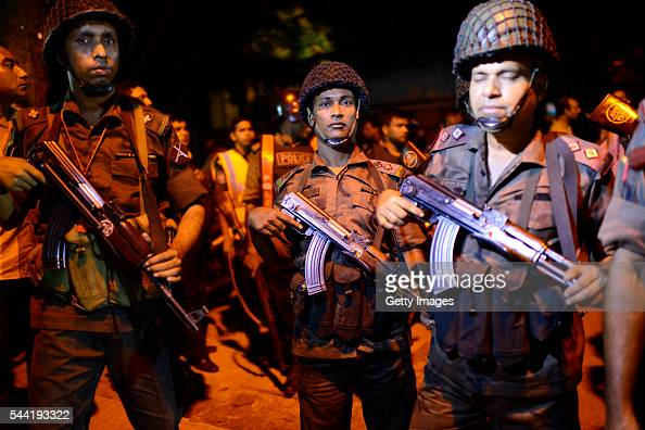 Bangladeshi security stand guard near a restaurant that has been attacked by unidentified gunmen on July 1 2016 in Dhaka Bangladesh Gunmen have taken...