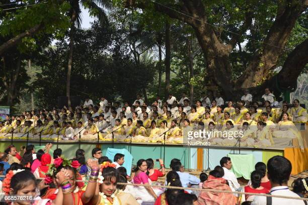 Bangladeshi singers are singing at a concert held to celebrate the first day of the Bangla New Year or quotPahela Baisshakhquot in Dhaka Bangladesh...