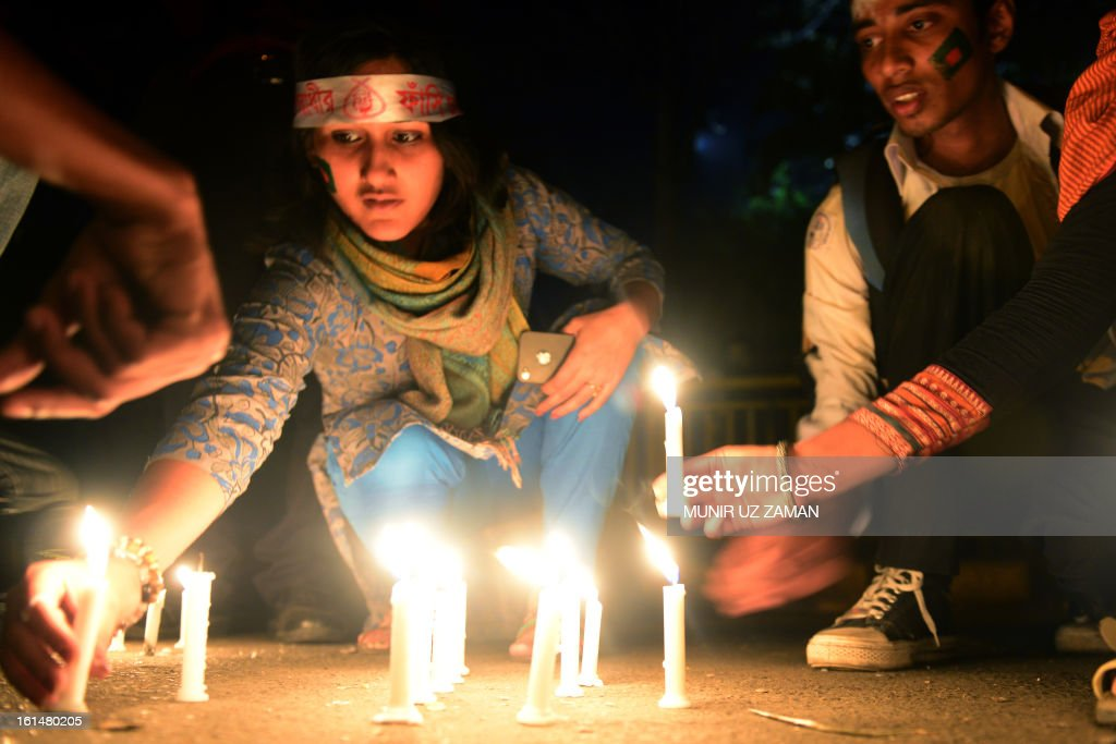 Bangladeshi social activists light candels in Dhaka on February 11, 2013, as they take part in seven day of protest calling for quick executions of the 10 alleged war criminals currently being tried on such charges as genocide and rape. Bangladesh's cabinet approved on today changes to war crime laws to ensure opposition leaders on trial for alleged atrocities during the nation's 1971 independence war can be swiftly executed if convicted. AFP PHOTO / Munir uz ZAMAN
