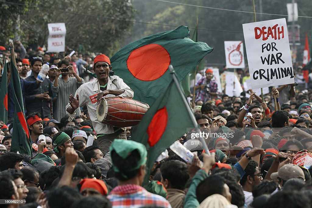 Bangladeshi social activists participate in a rally demanding the death sentence for the country's war criminals in Dhaka on February 8, 2013. Tens of thousands of people rallied Friday in the capital Dhaka and other cities to demand a ban on Bangladesh's largest Islamic party and the execution of its leaders who are on trial for war crimes.