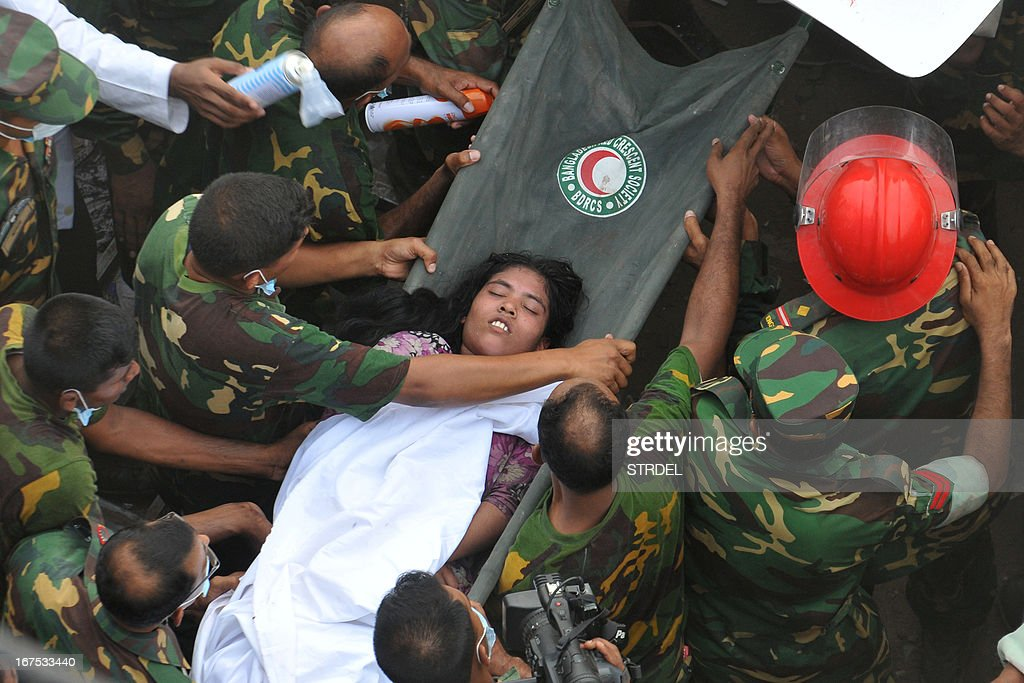 Bangladeshi soldiers evacuate a survivor after she was recovered, 60 hours later, from the rubble of a collapsed eight-storey building in Savar, on the outskirts of Dhaka, on April 26, 2013. A total of 304 people are so far known to have died after the eight-storey building collapsed in the town of Savar on April 24. Rescuers are racing against time to find more survivors in searing temperatures, watched on by hundreds of anxious relatives waiting for news of their missing loved ones.