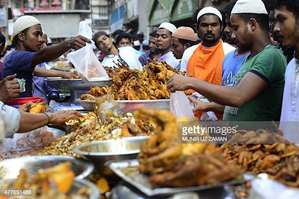 Bangladeshi street vendors prepare Iftar food for breaking the daytime fast on the first day of Ramadan the holy fasting month of Islam at a...