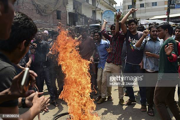 Bangladeshi students block the road and stage a protest following the murder of a law student hacked to death by four assailants the night before in...