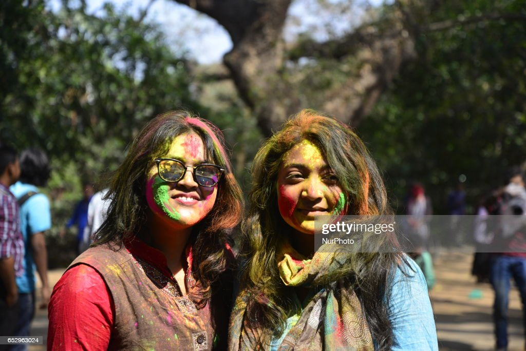 Bangladeshi students throw coloured powder during Holi celebrations at the Fine Arts Institute of Dhaka University on March 13, 2017. The Holi festival is celebrated to mark the onset of spring, with people from all walks of life coming out on the streets and applying coloured powder to anyone and everyone upon the advent of spring.