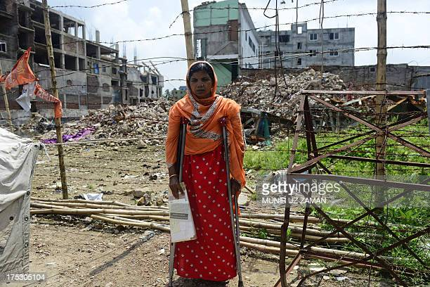 A Bangladeshi survivor of the April 24 garment building collapse poses at the site where the building once stood during the one hundredthday...