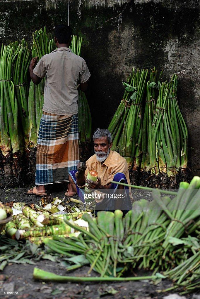 A Bangladeshi vendor preapres vegetables for sale at Karwan Bazar in Dhaka on October 7 2009 Karwan Bazar is one of the largest wholesale...