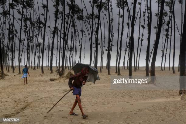 Bangladeshi villager evacuates to a cyclone shelter on the coast in Cox's Bazar district on May 30 2017 Cyclone Mora hit Bangladesh on May 30 packing...