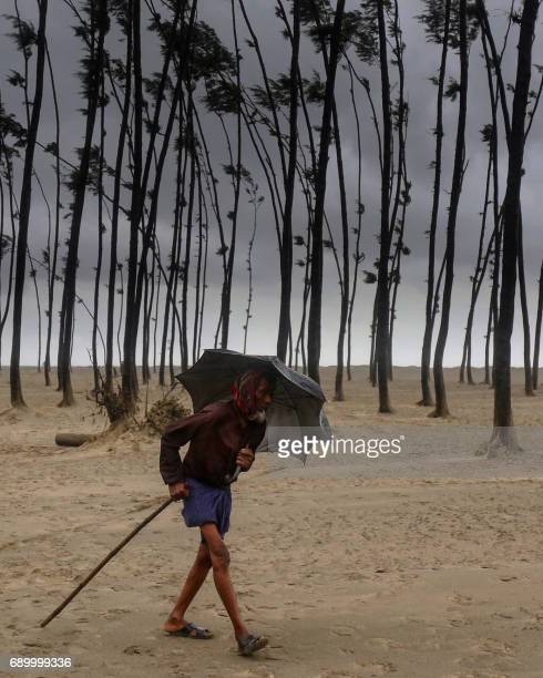 A Bangladeshi villager evacuates to a cyclone shelter on the coast in Cox's Bazar district on May 30 2017 Cyclone Mora hit Bangladesh on May 30...