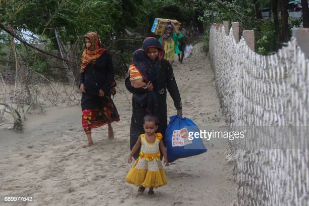 Bangladeshi villagers evacuate to cyclone shelters on the coast in Cox's Bazar district on May 30 2017 Cyclone Mora hit Bangladesh on May 30 packing...