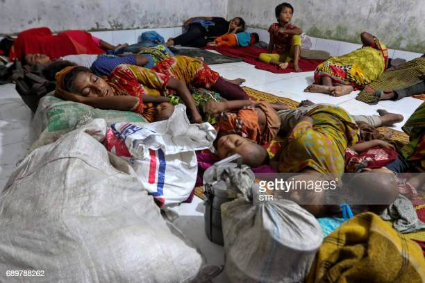 Bangladeshi villagers sleep in a cyclone shelter following an evacuation by authorities in the coastal villages of the Cox's Bazar district on May 29...