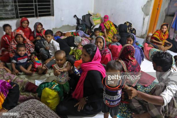 Bangladeshi villagers take refuge in a cyclone shelter following an evacuation by authorities in the coastal villages of the Cox's Bazar district on...