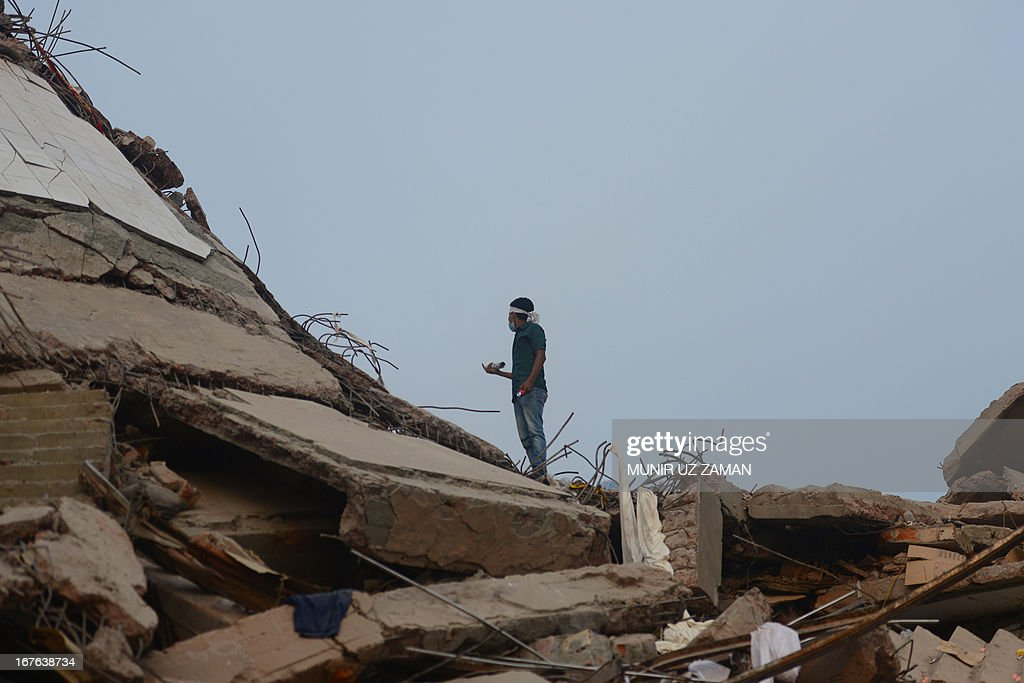 A Bangladeshi volunteer looks on as he helps in rescue operations three days after an eight-storey building collapsed in Savar, on the outskirts of Dhaka, on April 27, 2013. Police arrested two textile bosses over a Bangladeshi factory disaster as the death toll climbed to 332 and distraught relatives lashed out at rescuers trying to detect signs of life. AFP PHOTO/ Munir uz ZAMAN