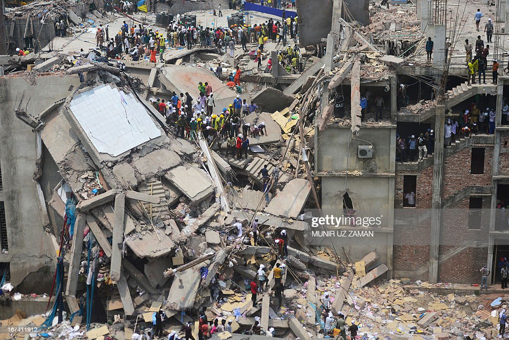 Bangladeshi volunteers and rescue workers assist in rescue operations after an eight-storey building collapsed in Savar, on the outskirts of Dhaka, on April 25, 2013. Survivors cried out to rescuers April 25 from the rubble of a block of garment factories in Bangladesh that collapsed killing 175 people, sparking criticism of their Western clients. AFP PHOTO/Munir uz ZAMAN