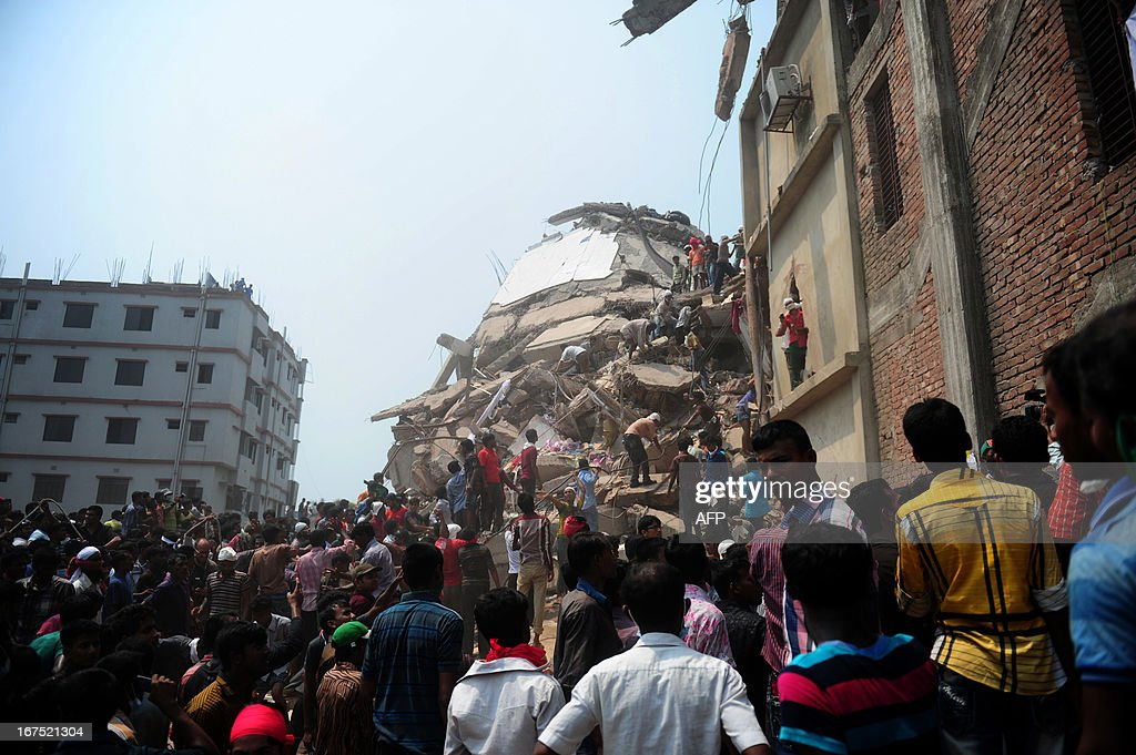 Bangladeshi volunteers and rescue workers assist in rescue operations 48 hours after an eight-storey building collapsed in Savar, on the outskirts of Dhaka, on April 26, 2013. At the disaster scene, where nearly 300 have been found dead, exhausted teams of soldiers, firemen and volunteers continued to work through the mountain of mangled concrete and steel for a third day after staying on the job for a second straight night. Amid frustration about the slow pace of the efforts, thousands of anxious relatives burst onto the disaster site, prompting police to fire tear gas to disperse the crowd.