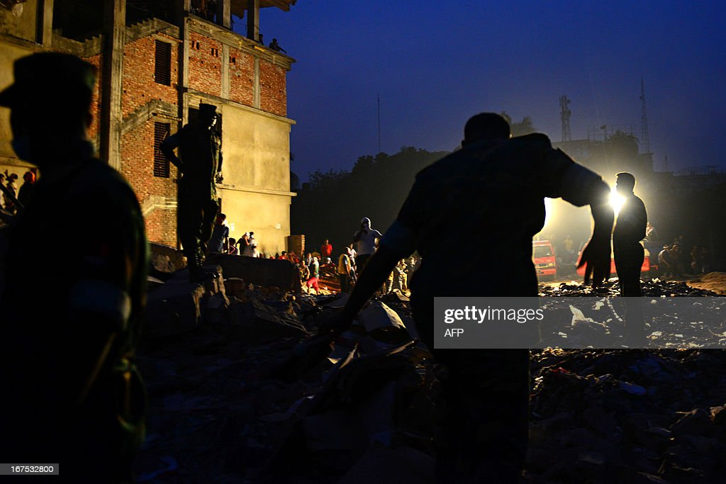 Bangladeshi volunteers and rescue workers conduct rescue operations 60 hours after an eight-storey building collapsed in Savar, on the outskirts of Dhaka, on April 26, 2013. A total of 304 people are so far known to have died after the eight-storey building collapsed in the town of Savar on April 24. Rescuers are racing against time to find more survivors in searing temperatures, watched on by hundreds of anxious relatives waiting for news of their missing loved ones.