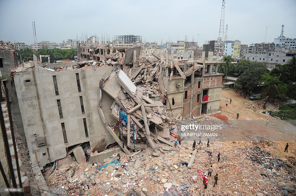 Bangladeshi volunteers and rescue workers search for survivors under rubble three days after an eight-storey building collapsed in Savar, on the outskirts of Dhaka, on April 27, 2013. Police arrested two textile bosses over a Bangladeshi factory disaster as the death toll climbed to 332 and distraught relatives lashed out at rescuers trying to detect signs of life. AFP PHOTO/ Munir uz ZAMAN
