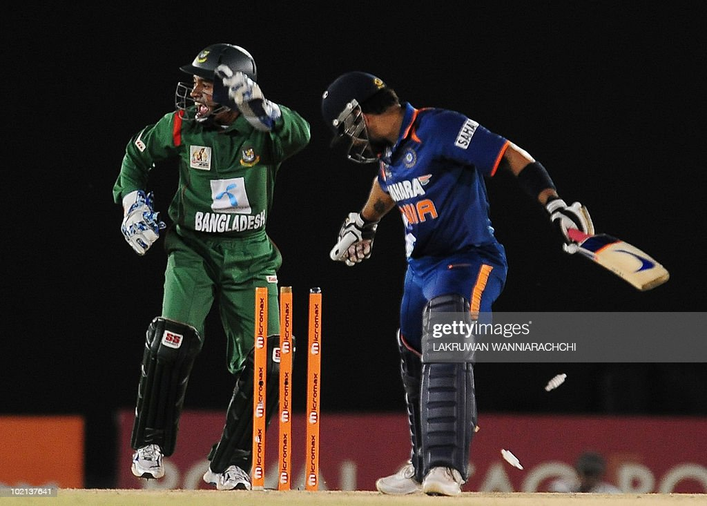 Bangladeshi wicketkeeper Mushfiqur Rahim (L) stumps Indian cricketer Virat Kohli (R) during the second One Day International (ODI) cricket match of the Asia Cup between India and Bangladesh at the Rangiri Dambulla International Cricket stadium in Dambulla, some 150 kms north of Colombo, on June 16, 2010. India is currently at 137 runs for the loss of three wickets in 27 overs as they chase Bangladesh's score of 167. AFP PHOTO/Lakruwan WANNIARACHCHI