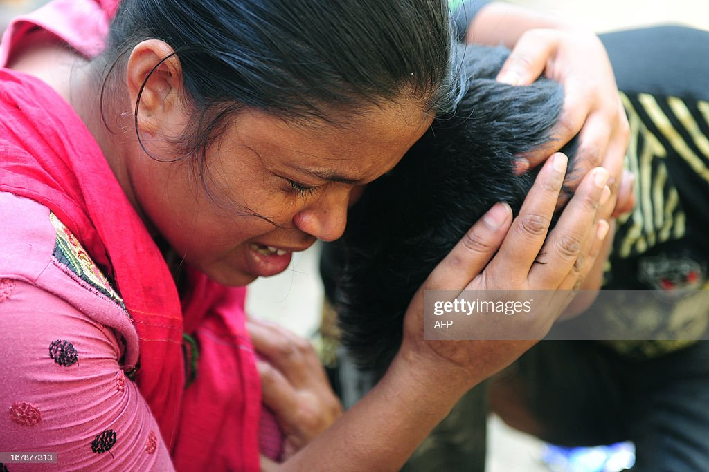 A Bangladeshi woman cries as she searches for her missing brother, believed to be trapped in the rubble of an eight-storey building collapse in Savar, on the outskirts of Dhaka,on May 2, 2013. Bangladesh authorities have suspended the mayor of Savar satellite town outside the capital for approving the faulty construction of a building that collapsed last week, killing 429 people. AFP PHOTO/ Munir uz ZAMAN