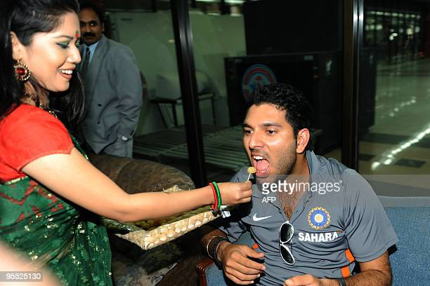 A Bangladeshi woman welcomes Indian cricketer Yuvraj Singh after arriving at the Zia International Airport in Dhaka on January 2 2010 The Indian...