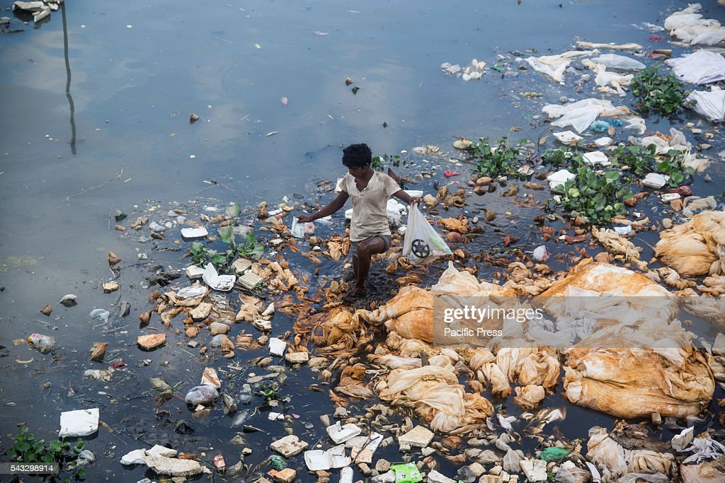 Bangladeshi worker working on polluted water on Turag River. Turag River is the most polluted river of Dhaka. A study shows that the water in the river was almost polluted and unsuitable for human consumption and aquaculture purposes.