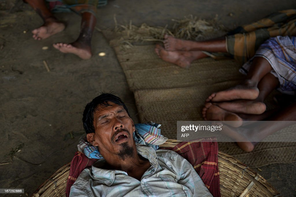 Bangladeshi workers sleep at a wholesale market in Dhaka on April 23, 2013, during a nationwide strike called by the Bangladeshi Nationalist Party (BNP) in protest against the detention of their leaders. The opposition alliance's 36-hour nationwide shutdown is being held to press for the release of their top leaders. Recent weeks in the South Asian nation have seen a nationwide crackdown on the opposition including the detention of more than 200 senior officials of the Bangladesh Nationalist Party (BNP) and the entire leadership of the largest Islamic party, Jamaat-e-Islami. AFP PHOTO/Munir uz ZAMAN