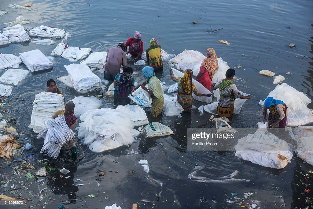 Bangladeshi workers working on polluted water at Turag River. Turag River is the most polluted river of Dhaka. A study shows that the water in the river was almost polluted and unsuitable for human consumption and aquaculture purposes.
