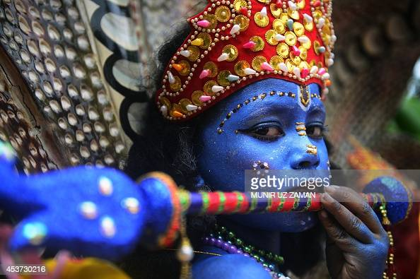 A Bangladeshi youth dressed as the Hindu god Lord Krishna takes part in a procession during celebrations for the Janmashtami festival in Dhaka on...