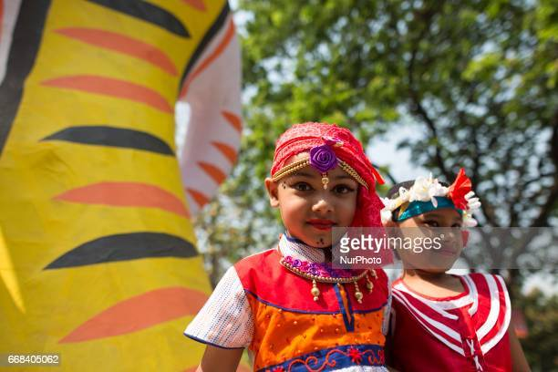Bangladeshis attend a rally in celebration of the Bengali New Year or Pohela Boishakh in Dhaka Bangladesh on April 14 2017 The day is celebrated...