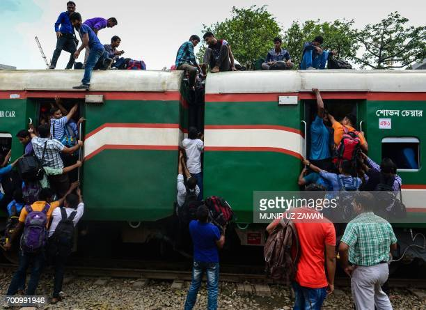 TOPSHOT Bangladeshis cram onto a train as they travel back home to be with their families ahead of the Muslim festival of Eid alFitr in Dhaka on June...