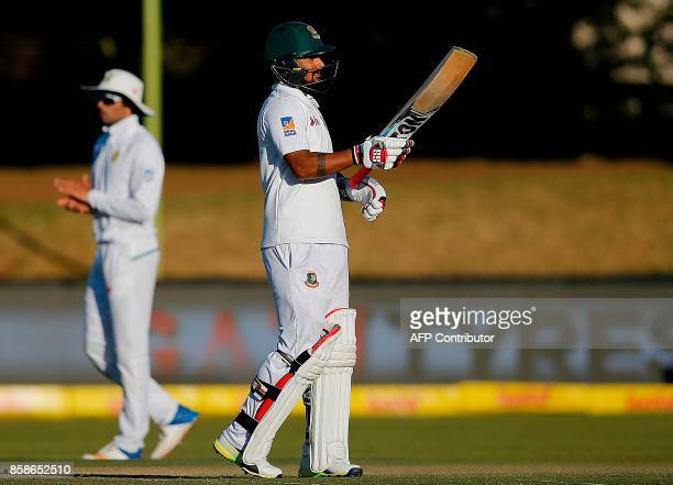 Bangladesh's batsman Liton Das acknowledges tbe crowd as he celebrates after scoring a halfcentury during the second day of the second Test cricket...
