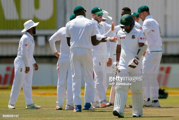 Bangladesh's batsman Liton Das walks back to the pavilion after his dismissal by South Africa's bowler Andile Phehlukwayo during the third day of the...
